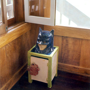 A batman in the can sculpture