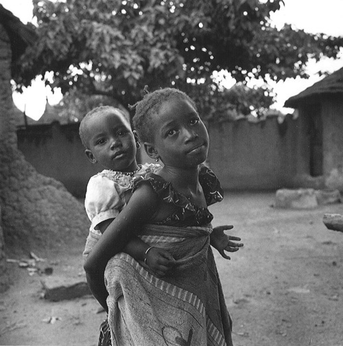 Girl carrying a younger girl